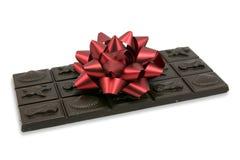 Chocolat foncé avec la proue rouge Photos libres de droits