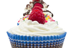 Chocolat muffin whit whipped cream and rapsberry Royalty Free Stock Photo