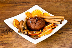 Chocolat muffin with orange slices and cinnamon Royalty Free Stock Photos
