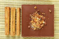 Chocolata and cinnamon sticks Royalty Free Stock Photography