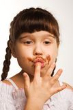 Chocolate. A photo of a girl, who just ate some chocolate Royalty Free Stock Photos