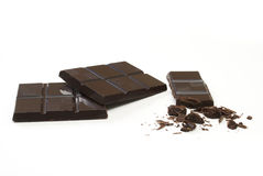 Chocolate. Pieces of chocolate with some crumbled off Royalty Free Stock Image