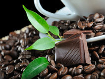 Chocolate. Block in coffee grains Stock Photography