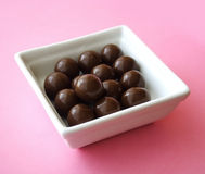 Chocolate. Delicious chocolate isolated on pink background stock photography