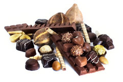 Chocolate. And diverse pralines, isolated on white Royalty Free Stock Photography
