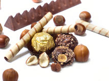 Chocolate. And diverse pralines, isolated on white Royalty Free Stock Images