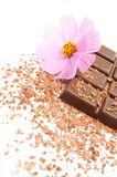 Chocolate. Dark chocolate with a flower on a white background Royalty Free Stock Photography