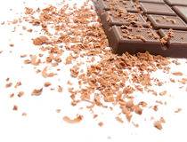 Chocolate. Bar of chocolate and chocolate chips on a white background Stock Image