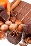 Chocolate. With cinnamon ,tangerines and different nuts in detail royalty free stock images