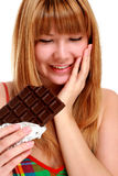 Chocolate. Chocolate girl. Beautiful girl with block of chocolate Royalty Free Stock Image