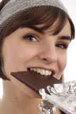 Chocolate. Stock Photo of a pretty young woman eating chocolate Royalty Free Stock Image