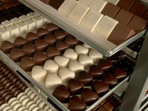Chocolate. Sweet chocolate bonbons waiting for boxing stock photo