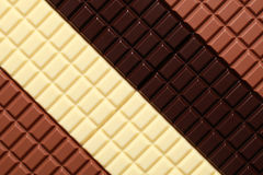 Chocolate. Different sorts of chocolate in a row royalty free stock photo
