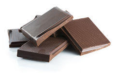 Chocolate. Broken chocolate bar on a white background Stock Photography