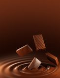 Chocolate. Pieces of chocolate falling into hot chocolate Stock Images