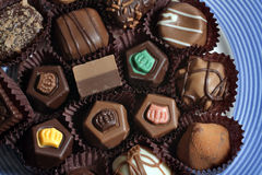 Chocolate. A closeup of various fresh chococlate candies on a plate stock images