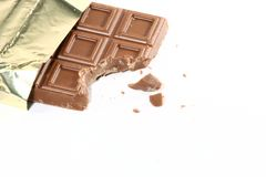 Chocolate. Partly unwrapped chocolate w/ crumbs Stock Photo