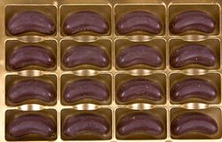 Chocolate. Rows of chocolate candies in box Stock Photography