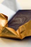 Chocolate. Unwrapping dark chocolate stock images
