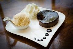 Chocolate acake nd Vanilla Ice Cream. On white plate royalty free stock images