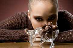 Chocolate addiction. Chocolate addiction, moody portrait of gorgeous brunette with chocolate pralines Stock Photo