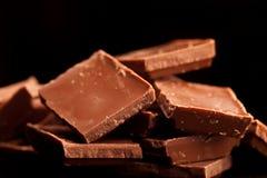Chocolate aislado en negro Imágenes de archivo libres de regalías