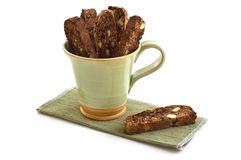 Chocolate Almond Biscotti. Fresh baked chocolate almond biscotti in green mug on white background Royalty Free Stock Images