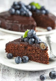 Chocolate almond cake with blueberry Stock Image