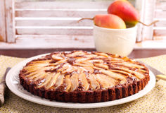 Chocolate and almond tart with pear royalty free stock photography