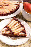 Chocolate and almond tart with pear stock images