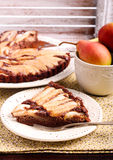 Chocolate and almond tart with pear stock photos