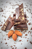 Chocolate with almonds nuts. Closeup Stock Images