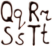 Chocolate alphabet letters. Alphabet letters made from chocolate syrup Stock Photography