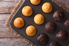 Chocolate And Vanilla Muffins In Baking Dish Top View Stock Image