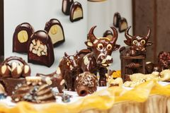 Chocolate animals decor. White and dark chocolate animals decor for cakes and others sweets Stock Photos