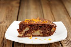 Chocolate apple cake with orange peels Stock Image