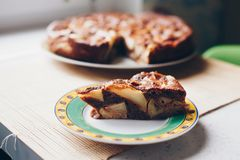 Chocolate-apple cake on wooden texture Royalty Free Stock Images
