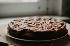 Chocolate-apple cake on wooden texture. Good pic for cafe or cafeteria Stock Photo
