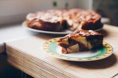Chocolate-apple cake on wooden texture Stock Photos