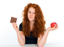 Chocolate or apple Royalty Free Stock Images