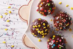Chocolate apples with sprinkles candy close up horizontal top vi Stock Images