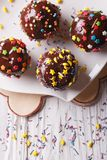 Chocolate apples with sprinkles candy close up vertical top view Royalty Free Stock Images