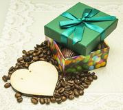 Chocolate as a gift on Valentine's Day and a wooden heart stock photos