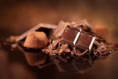 Chocolate. Assorted chocolate sweets and candies over dark background stock photo