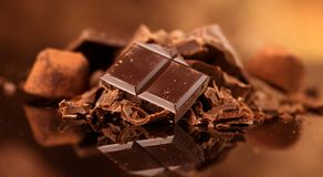 Chocolate. Assorted chocolate sweets and candies over dark background royalty free stock images