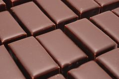 Chocolate background. Chocolate bars arranged in rows Royalty Free Stock Images