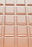 Chocolate Background. Vertical milk chocolate background with squares Royalty Free Stock Photos