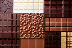 Chocolate background. Chocolate bar assortment pattern background wallpaper Royalty Free Stock Images