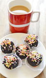 Chocolate ball topping colorful candy and red coffee cup Royalty Free Stock Photography