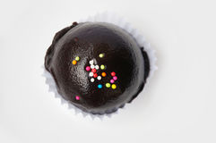 Chocolate ball with topping in paper cup Royalty Free Stock Photo